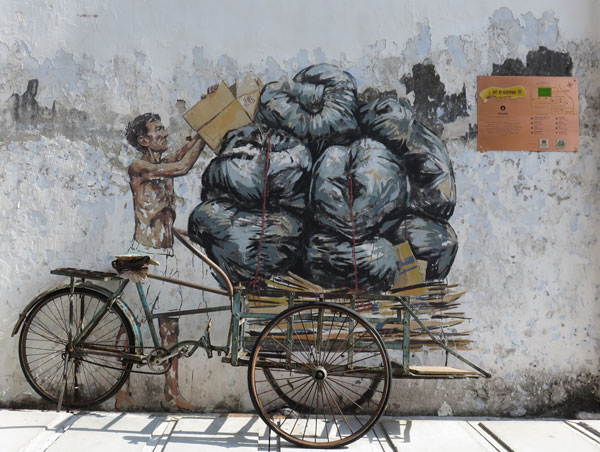 Art impression by Ernest Zacharevic of a man collecting recyclable items.