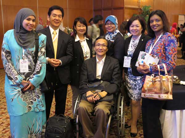 Ogawa (second from left) with senior job coach trainers and the writer at the Asia Pacific Supported Employment and Job Coach Seminar.