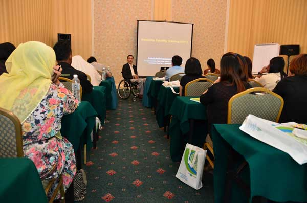 The writer conducting Disability Equality Training for SOCSO.