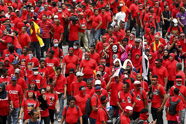'Red Shirt' demonstrators gather for a rally to celebrate Malaysia Day and to counter a massive protest held over two days last month that called for Prime Minister resignation over a graft scandal, in Kuala Lumpur. — Reuters file photo