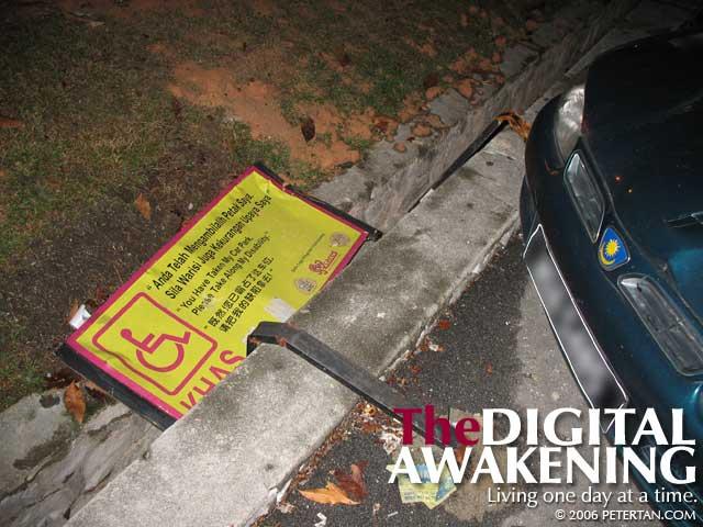 Knocked-down sign of accessible car park at SS2 Petaling Jaya